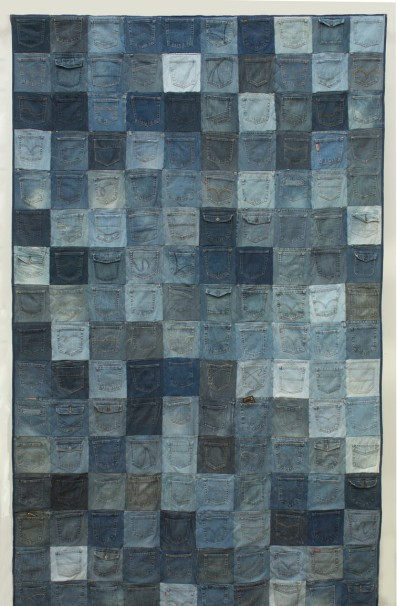 """Kim Dickey- Rest Assured, X Boyfriends: denim cotton batting, thread, condoms (130"""" x 86"""") *this is a hanging piece, but can be shot on the floor from high up- 2 sided."""