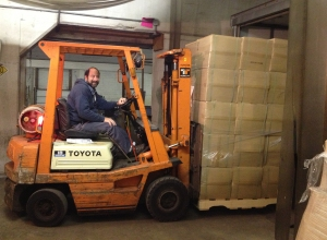 Mark Tepper unloading the delivery.  There were 26 pallets in total.